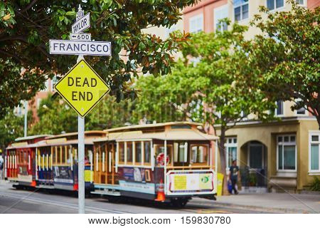 Street Sign And Cable Cars In San Francisco