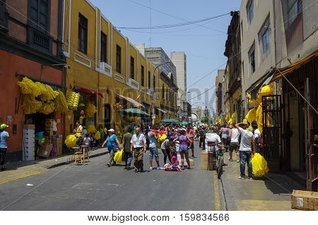 Lima, Peru -December 31, 2013: New year eve street market on one street of Lima city old town with traditional colorful houses