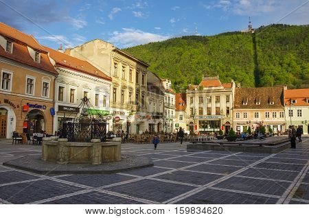 Brasov, Romania- April 29, 2015: Brasov Council Square is historical center of city with Black Church on background.