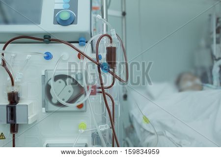 Hemodialysis apparatus connected to the patient in ICU.