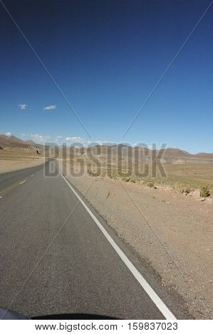 View of endless highway in the Chilean desert