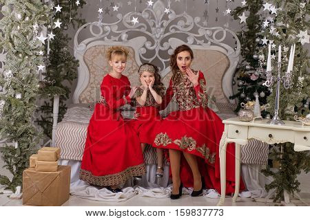 Three Girls In A Red Evening Dress The Christmas Tree.