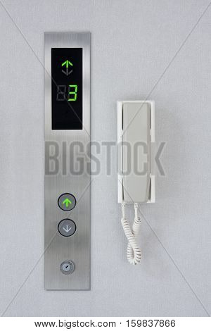 Press the elevator and elevator emergency phone.
