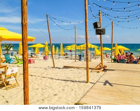 VARNA, BULGARIA - SEPTEMBER 06, 2016: City beach with yellow umbrellas, Varna, Bulgaria