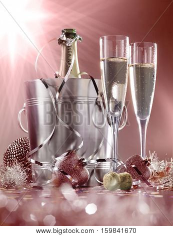 glasses of champagne with bottle in cooler on a red with white background