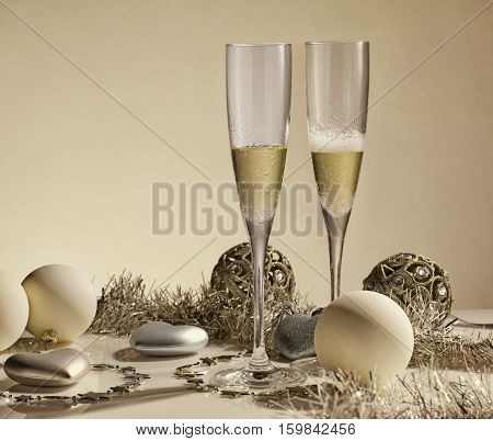 Two glasses with champange gift boxes and christmas decorations on a yellow background with lights of garland. New year and Christmas.