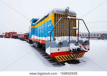 Freight train on the winter background.Locomotive of freight train.