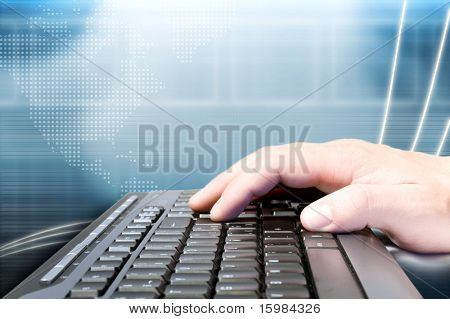Hand on keyboard and technology background