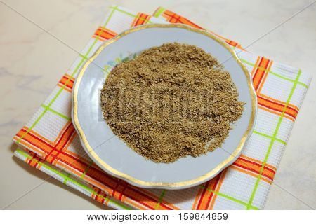 Wheat bran lie on a plate. Proper nutrition for good health. Ingredients for preparation of charlotte. Top view.