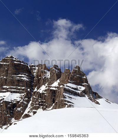 Snowy Rock And Sky With Clouds