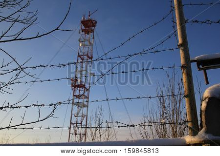 White-red Telecommunication Tower On Blue Sky Background