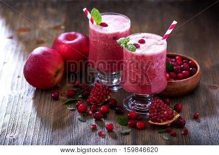 Fresh blended cranberry smoothie juicy healthy vitamin drink with berries diet and health concept