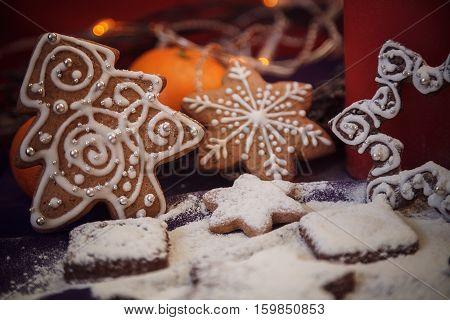 Christmas Gingerbread Cookies With Flour,  Festoon Lights On Purple Background.