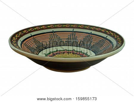 Ceramic plate painted in flanders technology. Flanders - common in Ukraine reception processing ceramics technique of painting on clay engobes in Ukrainian folk pottery crafts. Isolated on a white background