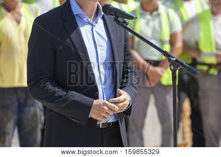 Politician or businessman is giving a speech
