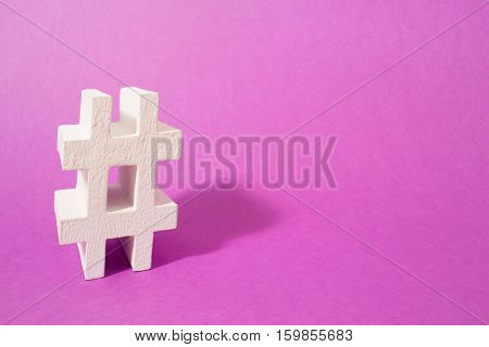 Volumetric hashtag on purple background. For the media and blogs.