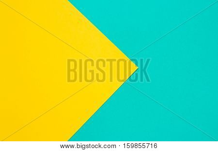 Coloured paper in the form of the sign PLAY. Yellow and turquoise conceptual background.