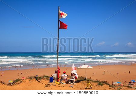 LIENCRES DUNES SPAIN - AUGUST 21: Lifeguards sitting on surveillance post in front of the sea on August 21 2016
