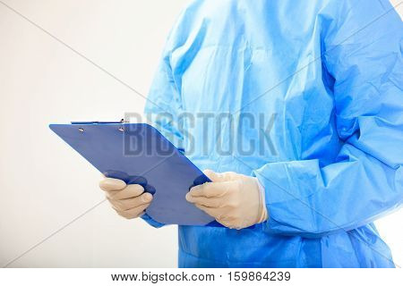 Surgeon Holding A Clipboard