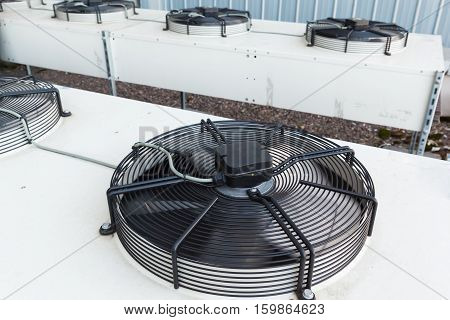 Cooling industrial air conditioning units closeup. Fans on condenser