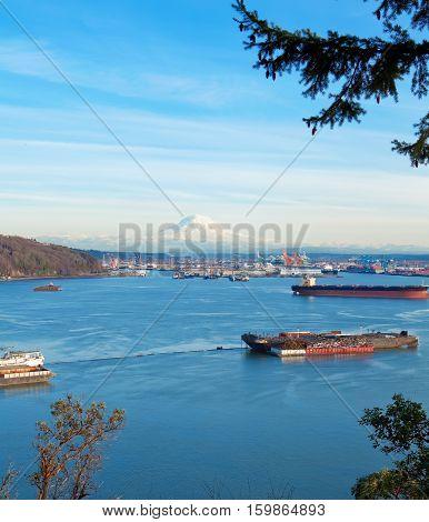 Tacoma Port With Cargo Ships And Volcano Mt. Ranier.