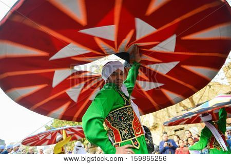 CAIRO, EGYPT, JANUARY 23 2016: :The dancer of Al Tannoura Folklore Troupe, Cairo, Egypt during the  International Folklore Festival held in the city center.