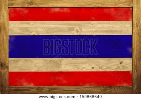 Thailand flag in wooden box with vintage color.