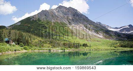 The panoramic view of Upper Dewey Lake 3100 feet (945 meters) above sea level (Skagway Alaska).