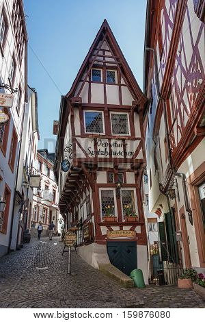 Bernkastel-Kues, Germany, April 21, 2015: a picturesque village with its typical timber framing houses along the Moselle river