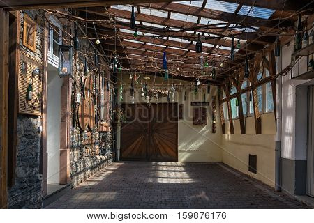 Bernkastel-Kues, Germany, April 21, 2015: garage decorated with wine bottles hanging from the ceiling.