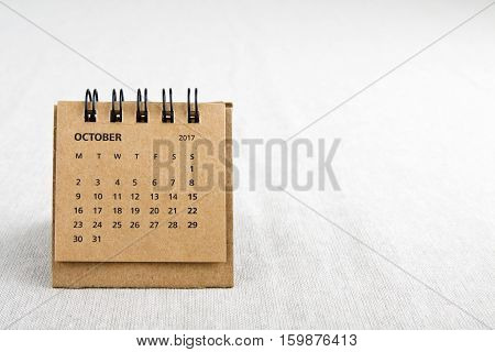 October. Calendar sheet. Two thousand and seventeen year calendar on bright background with copy space on right side.