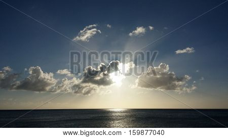 Light rays all around a sunset over the ocean. Turks and caicos islands.