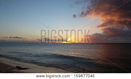 Sunset with light rays over the ocean. Turks and caicos islands.