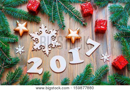 New Year 2017 background with 2017 figures Christmas toys fir branches-New Year 2017 still life. Concept of Happy New Year 2017 holiday with New Year objects. Flat lay top view of 2017 background