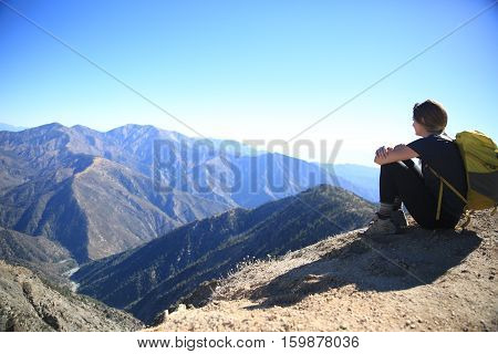 Hiker viewing the valley below Mt. Baden-Powell.