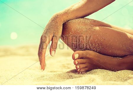Woman In Relaxation On Tropical Beach with sand , body parts