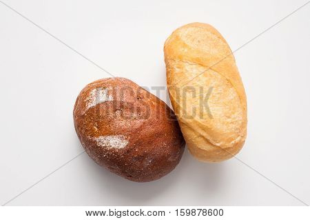 Loafs Of Bread – Brown And White.