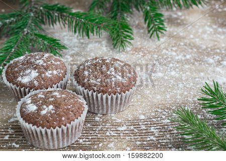 Three Christmas Cakes On Winter Snowbound Wooden Background, Fir Tree