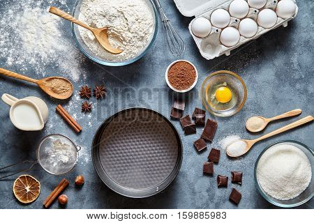 Dough preparation recipe bread, pizza, pasta or pie ingridients, food flat lay on kitchen table background. Working with butter, milk, chocolate, yeast, flour, eggs, sugar pastry or bakery cooking.