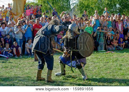 Kharkiv Ukraine - September 10 2016: Reconstruction of a medieval duel with swords during the ethnographic festival in Kharkiv region