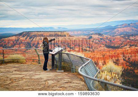 Tourist Enjoying Scenic View In Bryce Canyon National Park, Utah, Usa