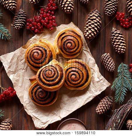 Cinnamon rolls buns with cocoa filling. Christmas baking and festive decoration. Kanelbulle swedish dessert. Top view.