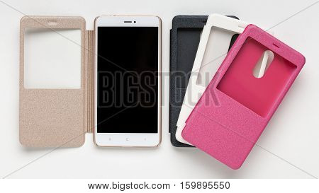 Set of colored plastic protective case for smartphone with a window isolated on a white background