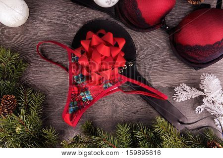 Top view of sexy presents for Christmas on wooden background.