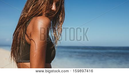 Sensuous Young Woman On The Beach