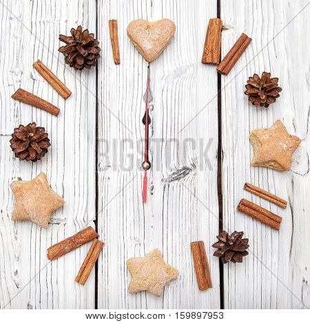 Christmas pine watch cone decoration on white wooden texture board