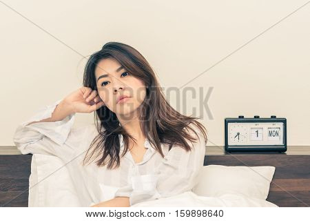 Tried Asian woman wake up in early morning. Trouble sleeping or insomnia concept