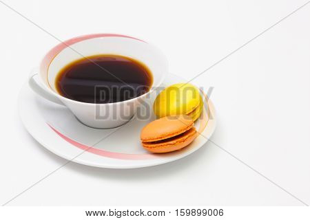 Coffee break - Cup of coffee and traditional french colorful macarons