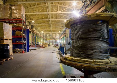 Warehouse industrial enterprise. The storage of steel coils of rope.