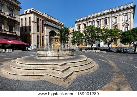 CATANIA ITALY - AUGUST 17 2016: 18th century Dolphins fountain on the Piazza Vincenzo Bellini originally designed by Giovanni Battista Vaccarini restored by Salvatore Giordano in the 1950s.